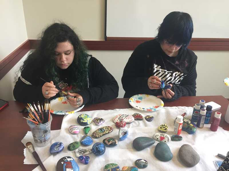 ESTACADA NEWS PHOTO: EMILY LINDSTRAND - Bella and Mayda Mosqueda work on creating painted rocks. Along with the rest of their family, they have been creating the rocks to create positivity in the Estacada community.