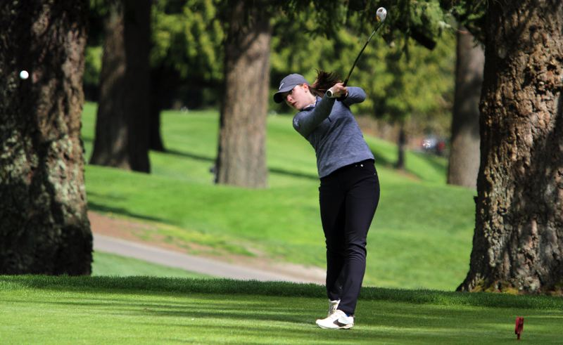 REVIEW PHOTO: MILES VANCE - Lakeridge's Olivia Ricketts launches a tee shot on the fifth hole during Monday's Three Rivers League tornament at Oswego Lake Country Club in Lake Oswego.