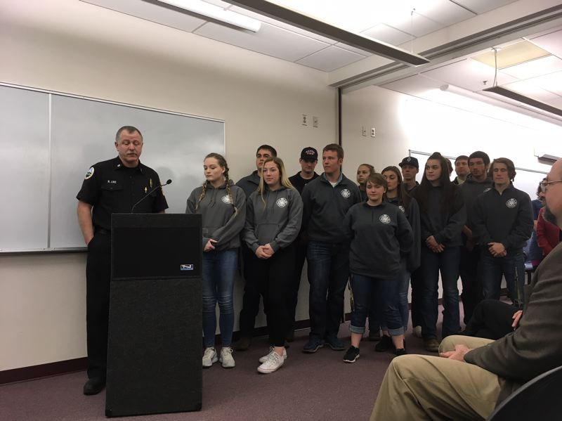 PAMPLIN MEDIA GROUP: PETER WONG - Banks Fire Chief Rodney Linz, left, and 13 students from the fire science class at Banks High School, which was recognized with the Emerging Leader in Public Health award.