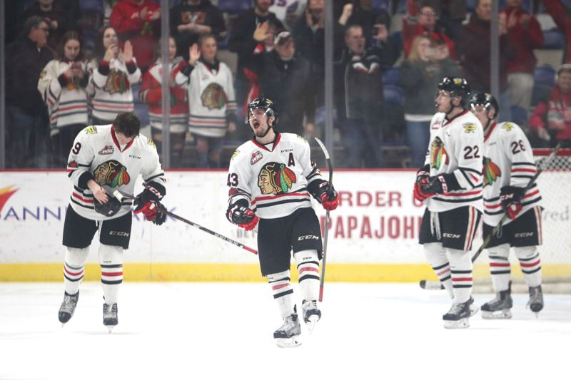 TRIBUNE PHOTO: JAIME VALDEZ - Skyler McKenzie (center) celebrates as the Portland Winterhawks finish off the Spokane Chiefs in Game 7 Tuesday night with a 3-1 victory at Memorial Coliseum.