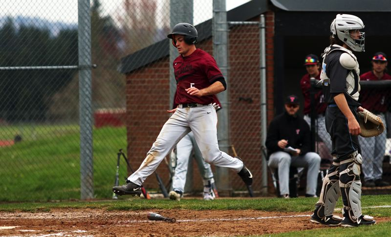 TIMES PHOTO: DAN BROOD - Tualatin High School junior Kyle Dernedde jumps to home plate during the Timberwolves nine-run first inning in the teams 20-0 win over Lakeridge.