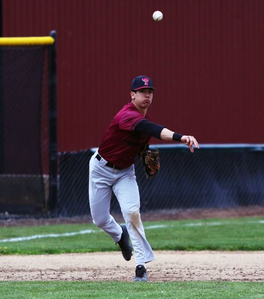 TIMES PHOTO: DAN BROOD - Tualatin High School junior third baseman Jett Searle makes a throw to first base during the Timberwolves 20-0 win over Lakerdige.