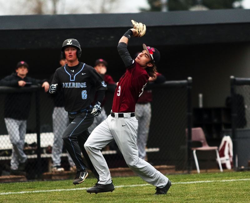 TIMES PHOTO: DAN BROOD - Tualatin High School senior Ryan Webb grabs the ball for the final out in the Timberwolves 20-0 league win over Lakeridge on Tuesday.