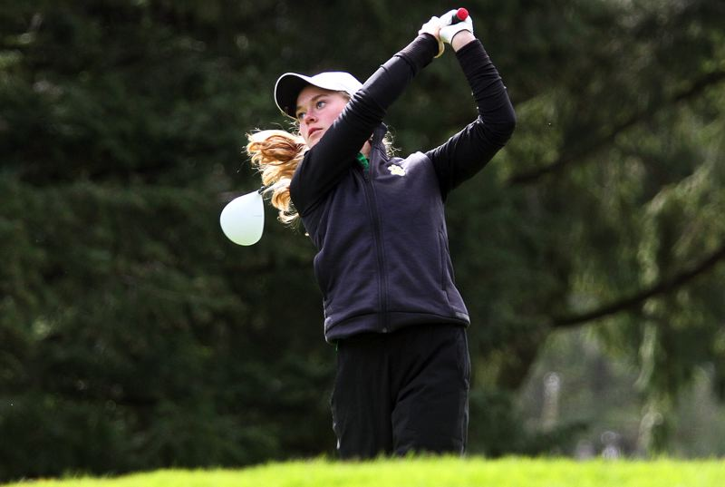 TIDINGS PHOTO: MILES VANCE - West Linn sophomore Olivia Venderby watches her tee shot fly during the Three Rivers League tournament at Oswego Lake Country Club on Monday.