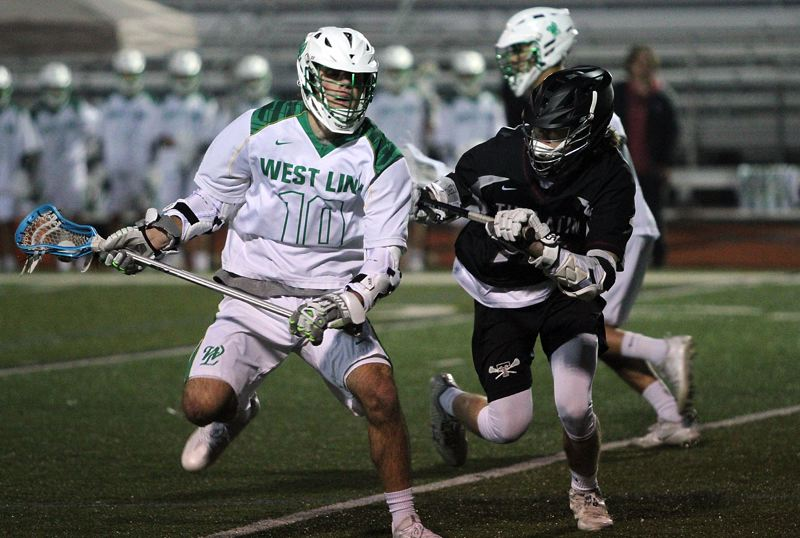 TIDINGS PHOTO: MILES VANCE - West Linn's Michael Stell makes a move during his team's 16-8 non-league win over Tualatin at West Linn High School on Tuesday.