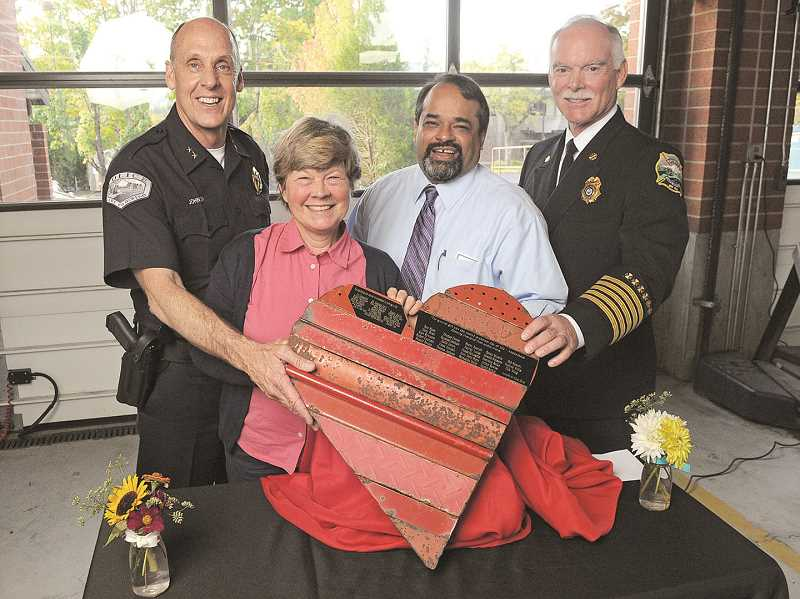 REVIEW FILE PHOTO: VERN UYETAKE - During Chief Don Johnson's tenure, the LOPD became the first law enforcement agency in Oregon to place AEDs in every police vehicle. Here, Johnson poses with artist Marla Farris, Medical Director Ritu Sahni and then-Fire Chief Ed Wilson at a Celebration of Survival event, where first responders and cardiac event survivors were honored.