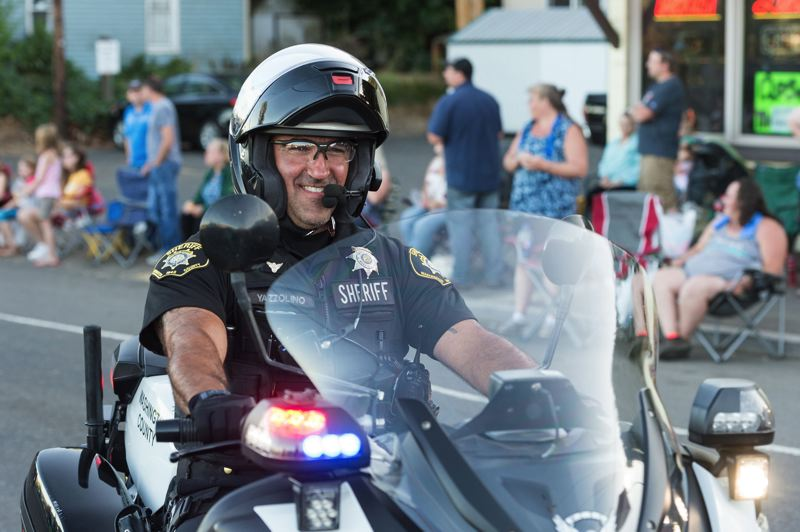 STAFF PHOTO: CHRISTOPHER OERTELL - It's not all hard work all the time for Washington County sheriff's deputies, as Deputy Joe Yazzolino is seen riding his motorcycle in last year's Gaston Good Ol' Days Parade.