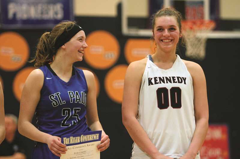 PHIL HAWKINS - St. Paul's Erin Counts (left) and Kennedy's Sophia Carley celebrate being named to the Tri-River All-Conference team in February. Carley won Conference Player of the Year and followed by winning a share of the 2A State Player of the Year award. Counts was a First Team All-Conference selection and a Second Team All-State selection.