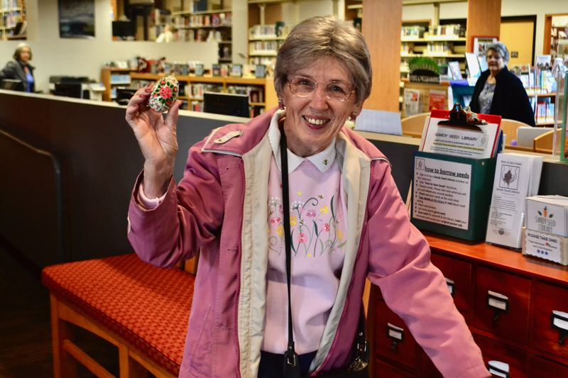 POST PHOTO: BRITTANY ALLEN - Sandy resident Ann Hall found one of six special wooden 'golden' eggs, winning a gift certificate for a local business.
