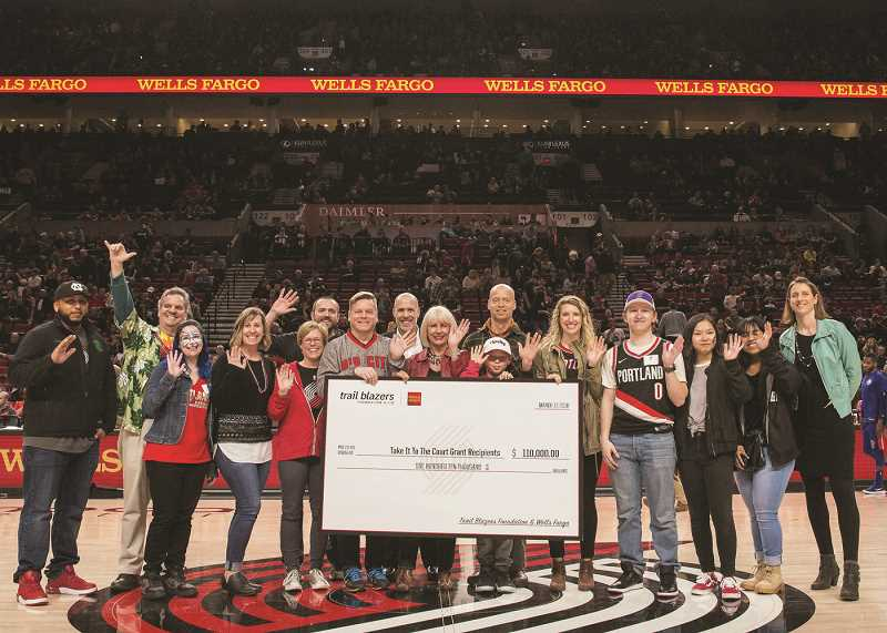 COURTESY PHOTO: WELLS FARGO - Two schools in Woodburn and one in Gervais were among 24 that received grants totaling $110,000 from Wells Fargo and the Trail Blazers Foundation in an event March 17 at the Moda Center arena in Portland.