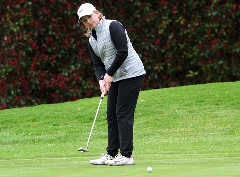 PAMPLIN MEDIA GROUP: MILES VANCE - Tigard High School senior Victoria Gailey watches her putt during play Monday at the Three Rivers League tournament held at Oswego Lake Country Club.