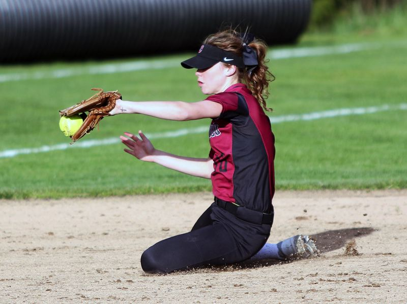 TIMES PHOTO: DAN BROOD - Sherwood High School sophomore shortstop Ema Kessler makes a diving catch during the Lady Bowmens game with David Douglas.