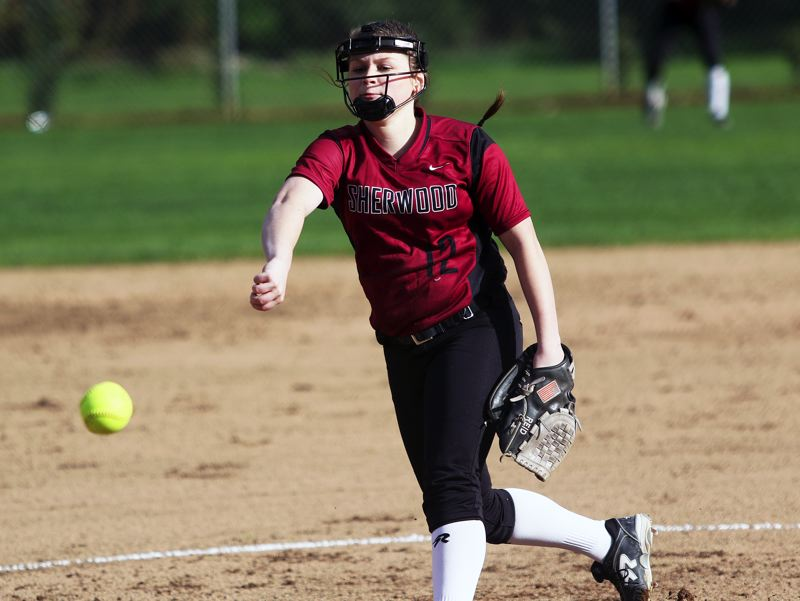TIMES PHOTO: DAN BROOD - Sherwood junior Josie Reid fires in a pitch during Monday's game against David Douglas.