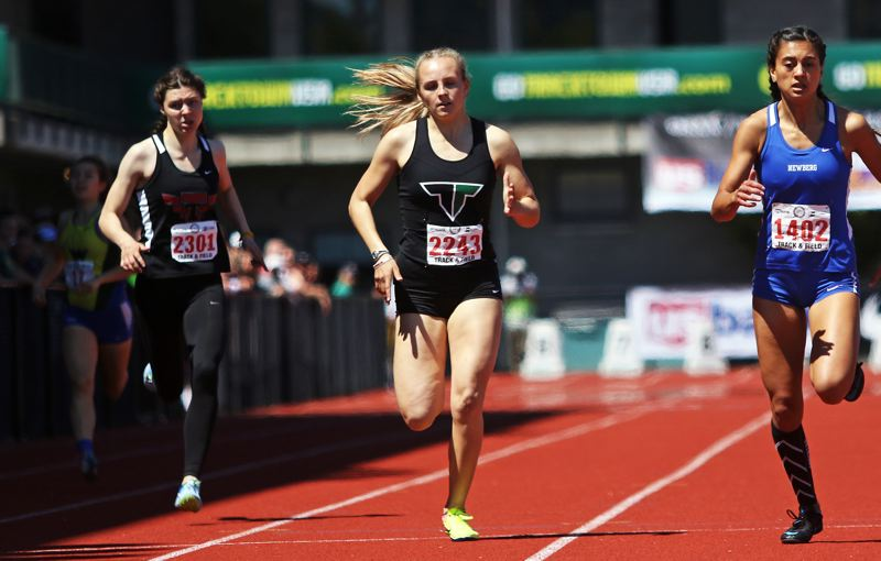 TIMES PHOTO: DAN BROOD - Tigard High School senior Lauren Paven finished second in the 400-meter dash at last years Class 6A state track and field championships.