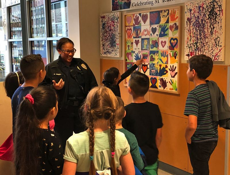 PHOTO COURTESY WASHINGTON COUNTY DISTRICT ATTORNEY'S OFFICE - Officer Kristan Rinell of the Tigard Police Department interacts with students on a daily basis as a school resource officer.