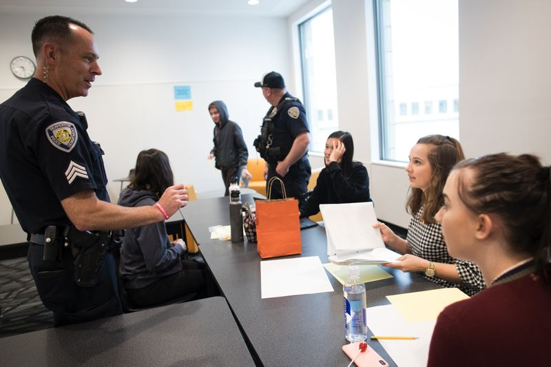 TIMES PHOTO: JAIME VALDEZ - Sgt. Kevin McDonald of the Beaverton Police Department interacts with students, staff and faculty.