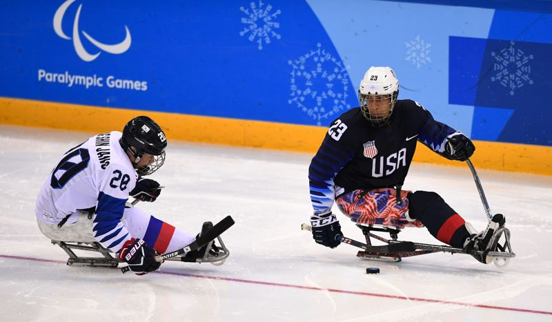 COURTESY: MARK REIS/USOC - Portland native Rico Roman (right) plays on the U.S. gold medal-winning sled hockey team during last month's Paralympics at PyeongChang, South Korea.