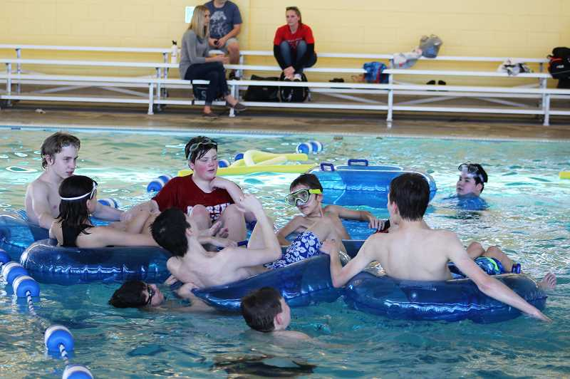 PIONEER PHOTO: KRISTEN WOHLERS - Kids enjoy open swim time at the Molalla Aquatic Center's reopening on March 31.