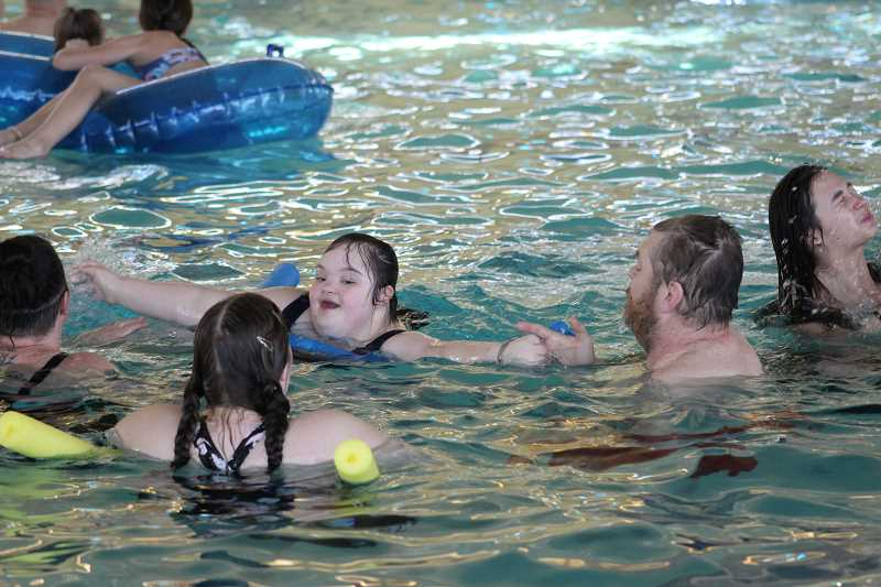 PIONEER PHOTO: KRISTEN WOHLERS - People of all ages enjoy the waters of the newly opened pool.