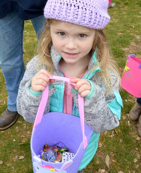 PIONEER PHOTO: CINDY FAMA - Four-year-old Emy Louise Hordichok shows off her hunt treasures.