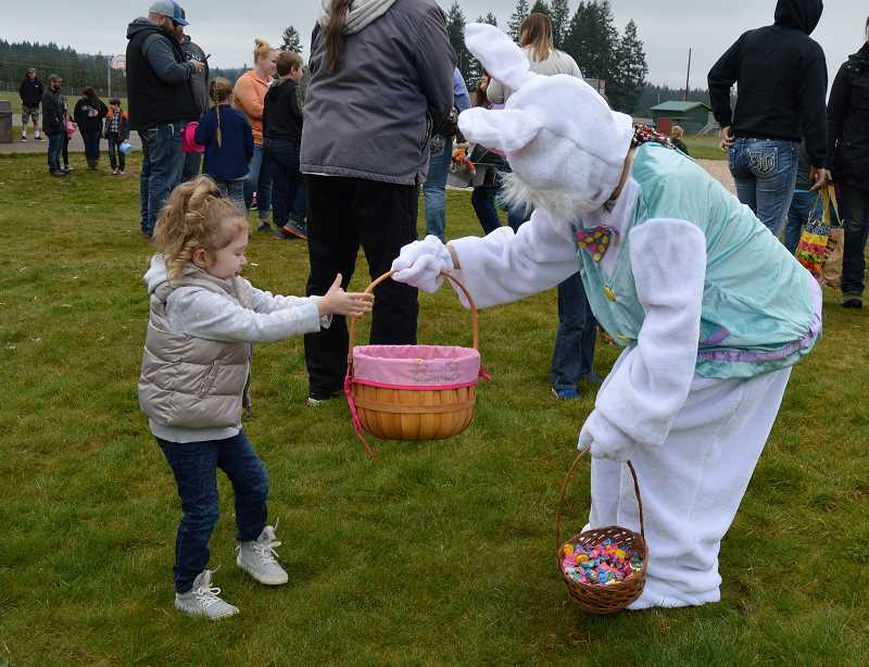 PIONEER PHOTO: CINDY FAMA - Three-year-old McKenzie Cornwell shows the Easter Bunny her basket.