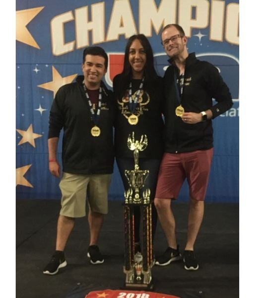 SUBMITTED PHOTO - Pony Prancer assistant coaches Jonathan Sanford and Basha Rei join Head Coach Ryan Sanford in celebrating the first-place trophy. Rei and Sanford are MHS Pony Prancer alumni.
