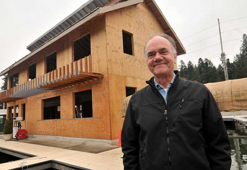 REVIEW PHOTO: VERN UYETAKE - Lake Oswego Corporation Manager Jeff Ward stands outside the new two-story marina building, which is still under construction.