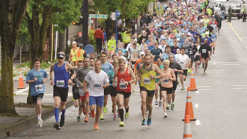 REVIEW FILE PHOTO: VERN UYETAKE - Lake Run participants may start on flat downtown roads, but the annual event is really known for its hilly terrain and breathtaking views.