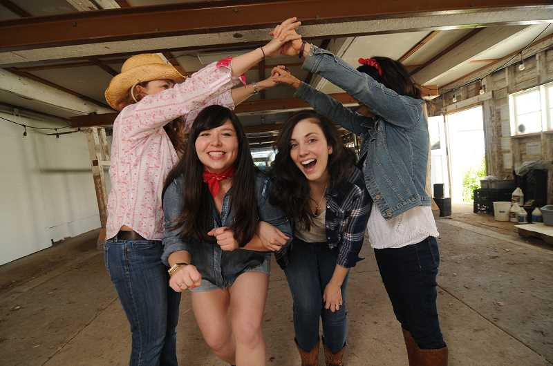 REVIEW PHOTO: VERN UYETAKE - Jamie Inglis (center left) and Madeline Marin-Foucher pose with fellow Parks employees Dawn Kolb and Kathy Schilling as a promotion for a barn dance at Luscher Farm.
