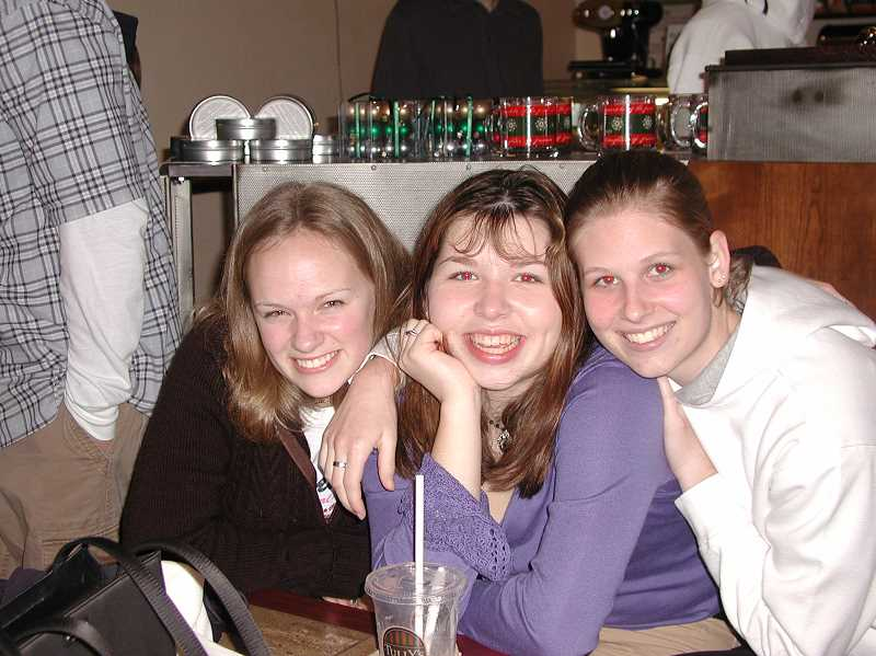 SUBMITTED PHOTO: JAMIE INGLIS  - Jenny Oertell (left), Briana Bay (right) and Jamie Inglis (center) pose for a photo while organizing the Java Jam teen event in 2003.