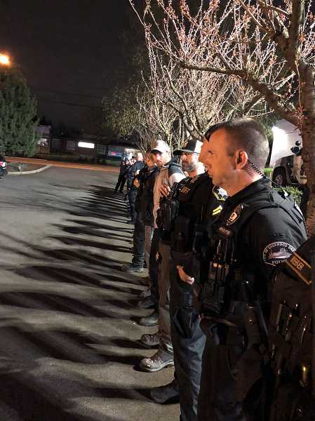 COURTESY - Officers with the Hillsboro Police Department stand at attention during a ceremony honoring Timber shortly before the dog was euthanized Wednesday, April 4.