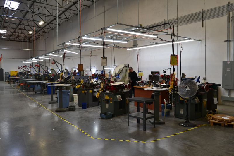 PAMPLIN MEDIA GROUP: JULES ROGERS - Rows of fourslides and other precision machines line the companys new warehouse floor in Tualatin.