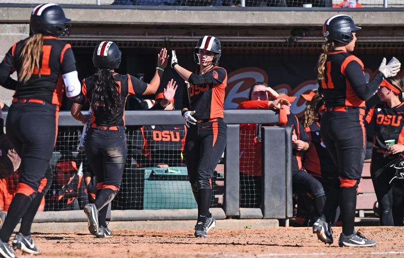 COURTESY OREGON STATE UNIVERSITY - Michelle Sass (center) served mainly as a pinch runner in her first two years at Oregon State, but now has become a mainstay.
