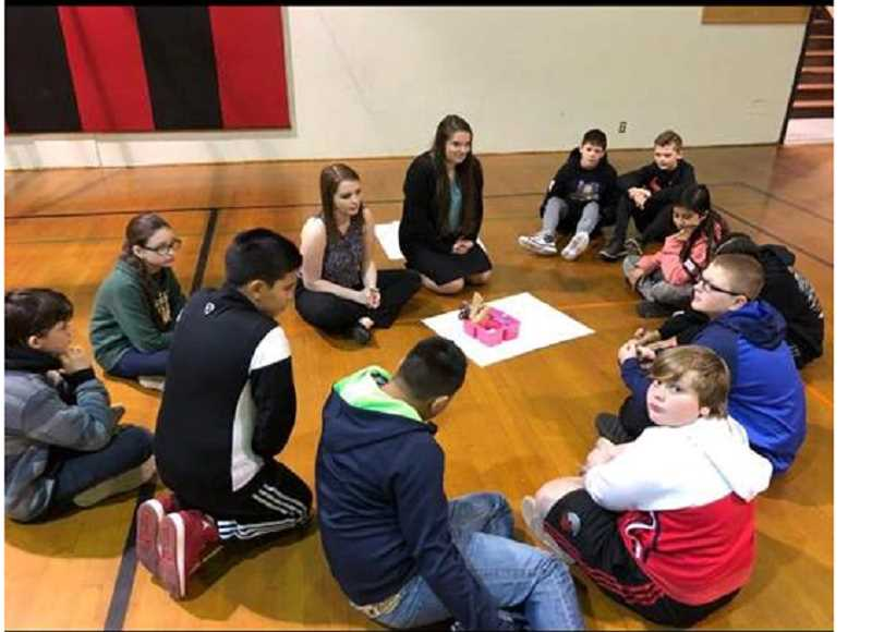 SUBMITTED PHOTO: SHELBY HELMIG - Molalla FBLA members visited the middle school to promote entrepreneurship in March.