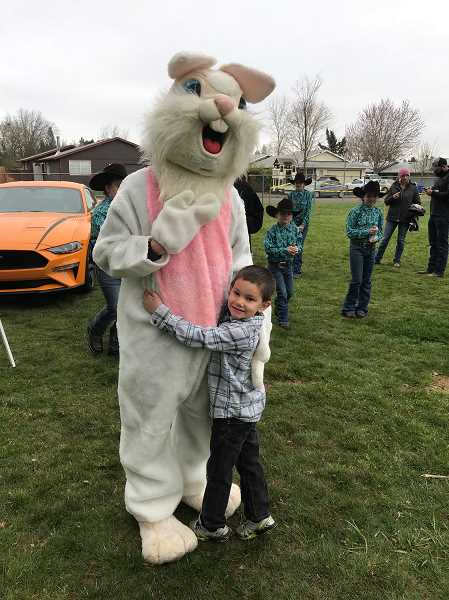 SUBMITTED PHOTO: CHARLIE WILLIAMS - The golden egg winner hugs the Easter Bunny at Molalla's Easter Egg hunt on March 31.