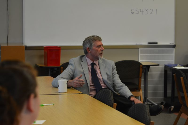 SPOTLIGHT PHOTO: COURTNEY VAUGHN - Ron Alley converses with parents Wednesday evening, April 4, during a meet-and-greet session hosted by the Scappoose School District.