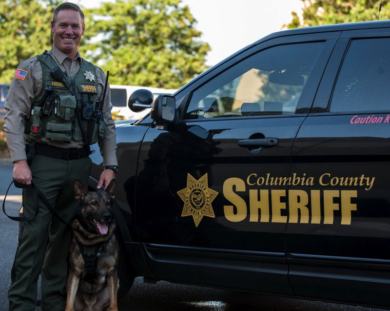 COLUMBIA COUNTY SHERIFFS OFFICE PHOTO - Odin and his handler, Columbia County Sheriffs Deputy Derek Hibbs, were recently certified in narcotics detection. The duo will now be able to assist law enforcement agencies on calls involving drug possession or trafficking.