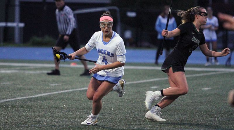 REVIEW PHOTO: MILES VANCE - Lakeridge's Marie Hartfield turns upfield after making a steal during her team's 18-10 home loss to Jesuit on Thursday night.