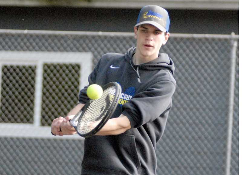 PHOTO COURTESY OF MATT RAWLINGS/ESTACADA NEWS - Jordon Owens plays a shot during the No. 2 doubles match Tuesday night in Estacada. Owens and doubles partner Garrett Bond earned their first win of the year as they edged Estacada's Caleb Brotnov and Carson Eaton 7-5, 7-5.  The Cowboys won all but one match on the day as they defeated the Rangers 7-1.