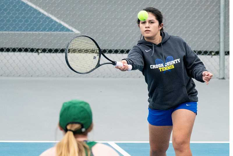 LON AUSTIN/CENTRAL OREGONIAN  - Angela Andaluz plays a winning shot during the No. 3 doubles match on Tuesday against Estacada. Andaluz and her partner, Hannah Love, went on to win the match 6-4, 6-3 as Crook County won the competition 7-1.