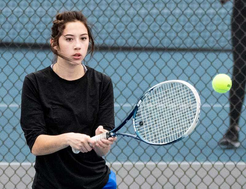LON AUSTIN/CENTRAL OREGONIAN - Britney Vanderjagt returns a shot against Estacada's Katie Day. Vanderjagt outlasted Day 6-4, 6-4 to win the No. 1 singles match. Crook County rolled to an easy 7-1 victory over the Rangers.