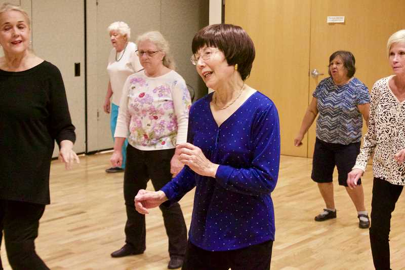OUTLOOK PHOTO: CHRISTOPHER KEIZUR - Atchan Akagi leads her line dancing class twice a week at the Gresham Senior Center.