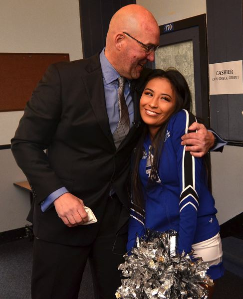 OUTLOOK PHOTO: VERN UYETAKE - Principal Michael Schaefer gives senior and cheerleader Citlaly Arroyo a playful hug after she complained about the lack of student parking.