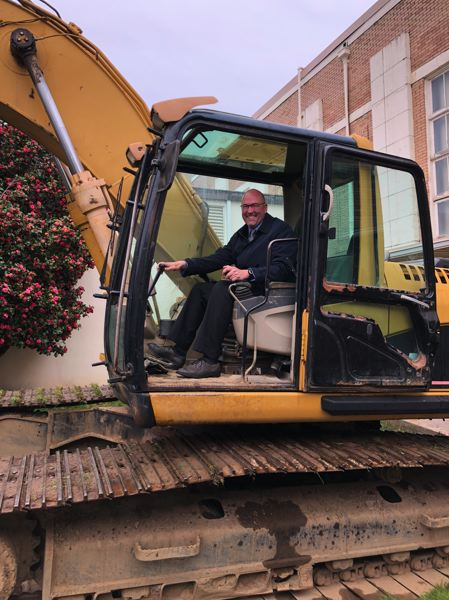 CONTRIBUTED PHOTO: GRESHAM-BARLOW SCHOOL DISTRICT - Gresham High Principal Michael Schaefer tries his hand at the earth moving equipment that will be working at his school in the rebuild over the next two years.