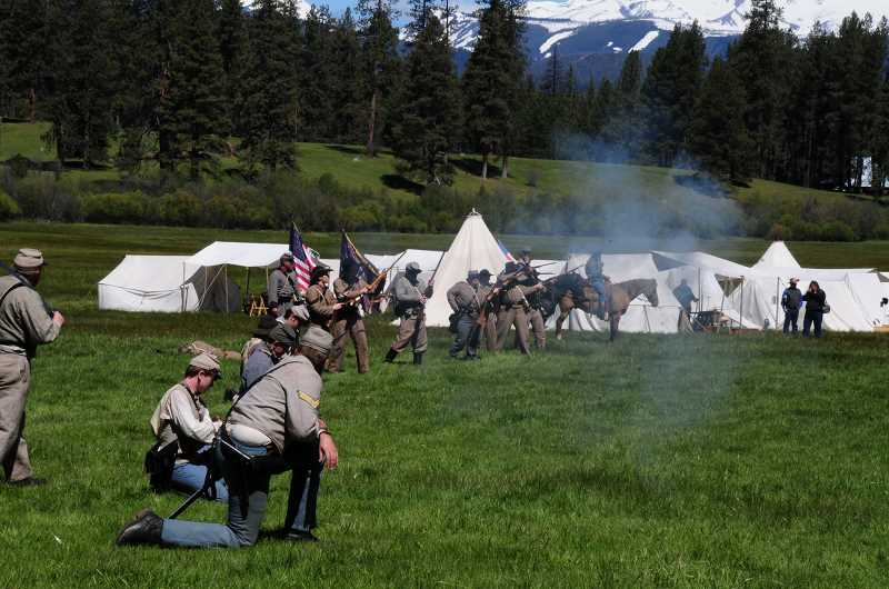 BILL VOLLMER  - Civil War re-enactors cover the Metolius Meadow near Camp Sherman during last year's re-enactment.