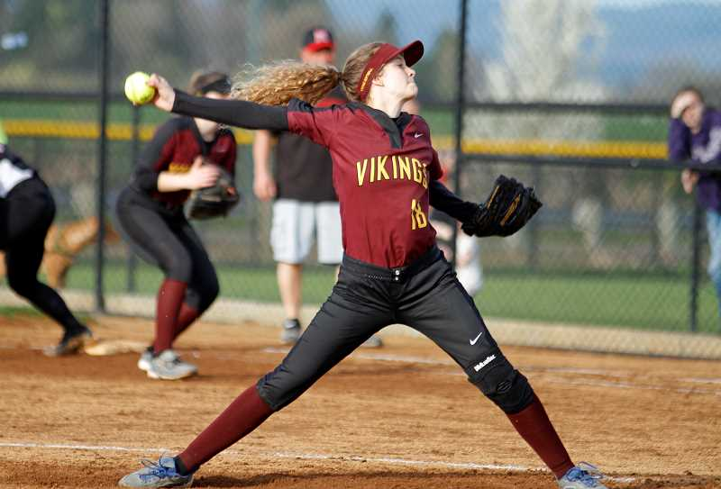 STAFF PHOTO: WADE EVANSON - Forest Grove's Carmen Sahlfeld hurls a pitch in relief during the Vikings' game against McMinnville April 6 at Forest Grove High.