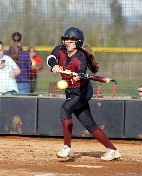 STAFF PHOTO: WADE EVANSON - Forest Grove's Vanessa Gonzalez lays down a bunt during the Vikings' game against McMinnville April 6 at Forest Grove High.