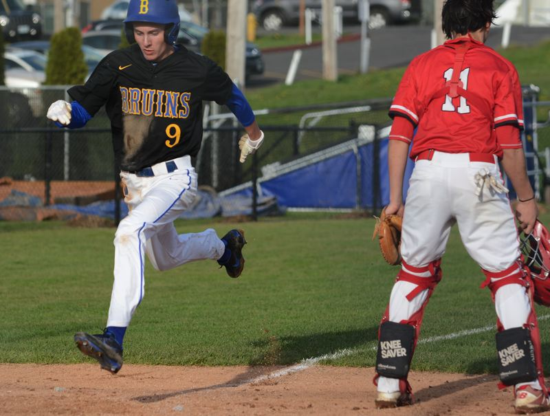 OUTLOOK PHOTO: DAVID BALL - Barlow pinch-runner Kanyan Wallace flies home with the tying run during the seventh inning of the Bruins' 4-3 win over David Douglas on Friday.