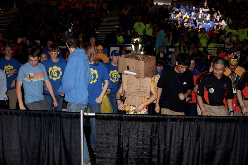 TRIBUNE PHOTO: ZANE SPARLING - Students bust a move during a break of the FIRST Robotics championship in Portland.