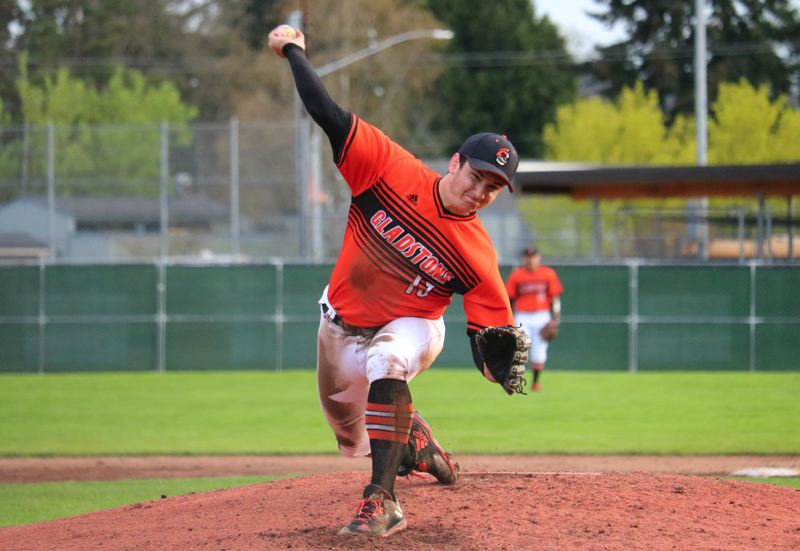 PAMPLIN MEDIA PHOTO: JIM BESEDA - Gladstone's Ben McCoy pitched five innings and scattered seven hits with one walk and five strikeouts in Friday's 16-2 Tri-Valley Conference baseball blowout win over Corbett.